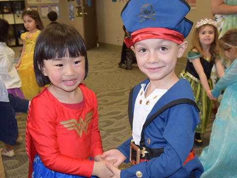 two lower school students dressed in as wonder woman and a pirate