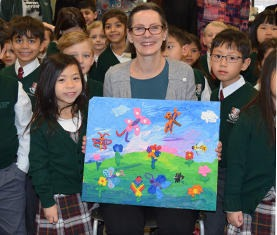 Students and their teacher with student art
